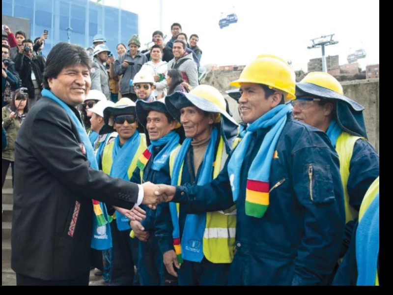Figure 4. President Evo Morales greets construction workers,